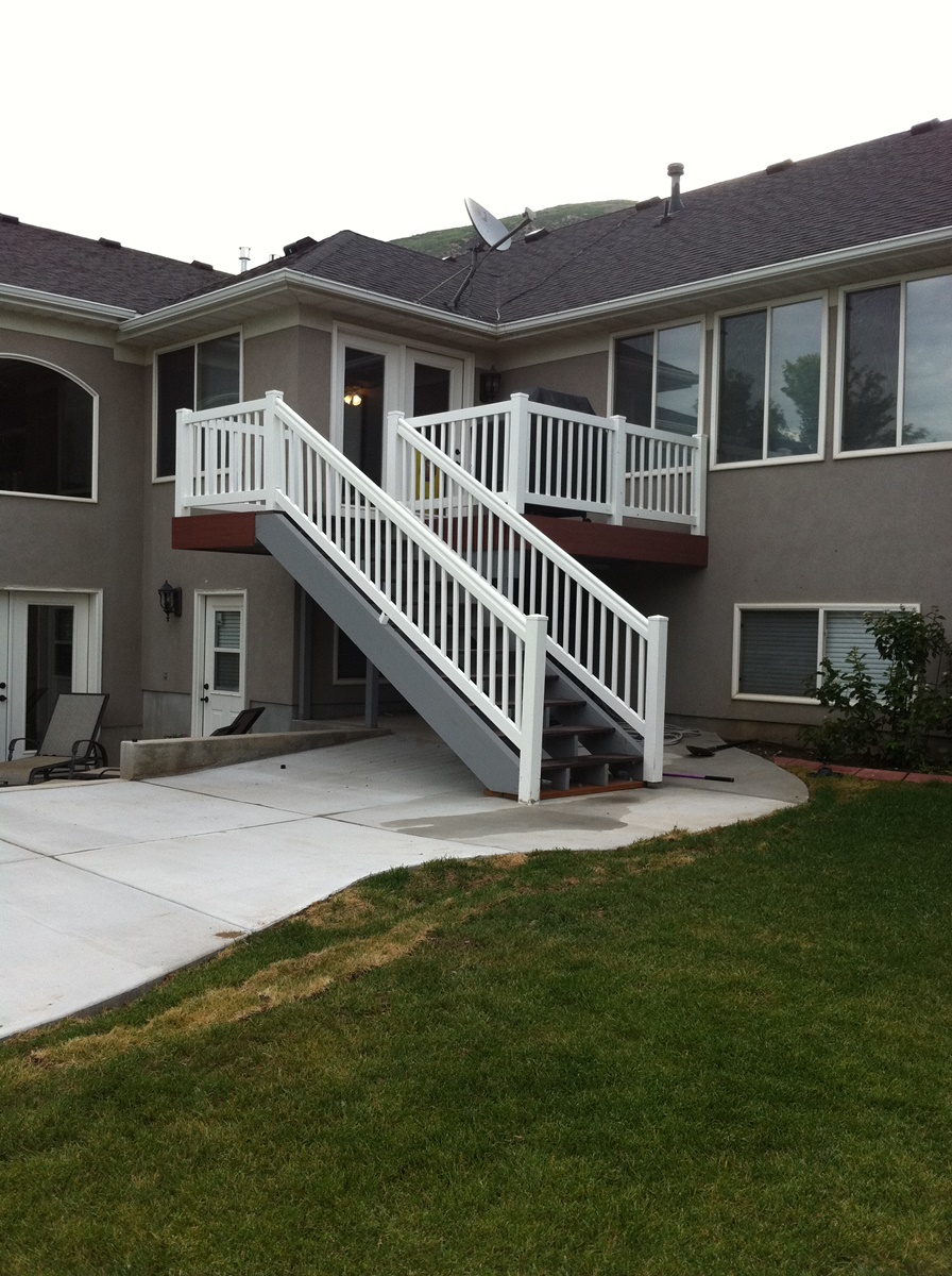 house with deck and outdoor stairs